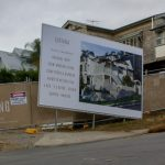 Real estate billboard and fence mesh banner at Luciana